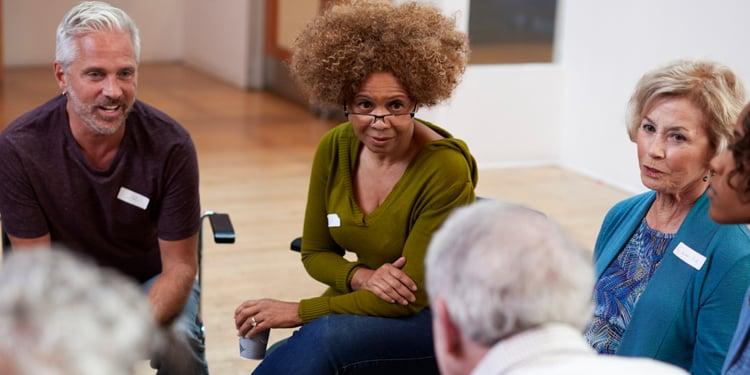 Woman leading employee benefits focus group