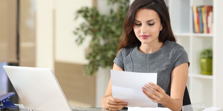 business woman office letter reading_750x375-1.jpg