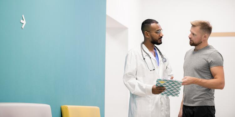 Young man talking to a doctor