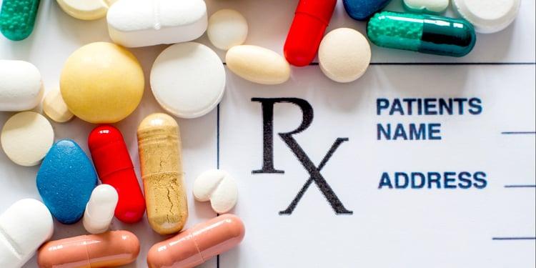 Prescription medication surrounding a prescription pad