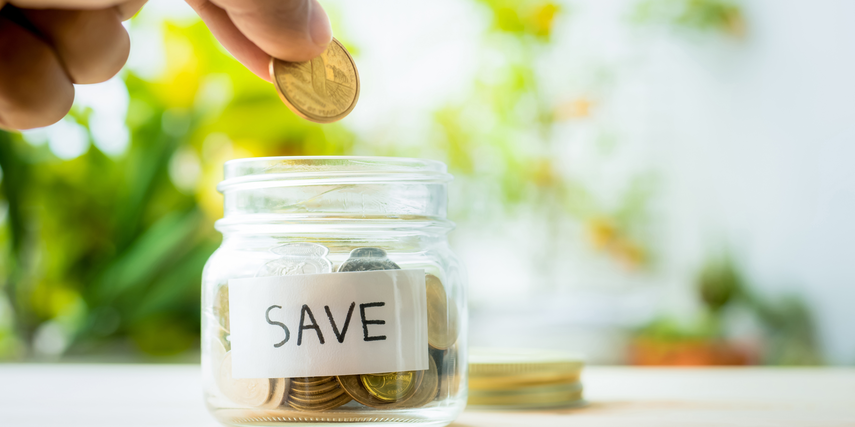 save money coin jar hand_750x375.jpg